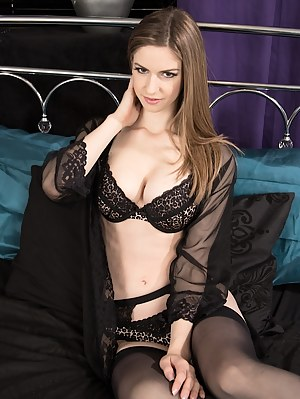 Brunette coed Stella Cox naked in only black stockings.
