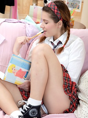 Innocent teen schoolgirl strokes her young soaked pussy