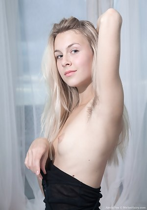 Alecia Fox wakens in her black dress and is very horny. The dress is taken off and we peek at her hairy pits and hairy pussy. She then poses nude in various ways, and looks absolutely stunning in bed.