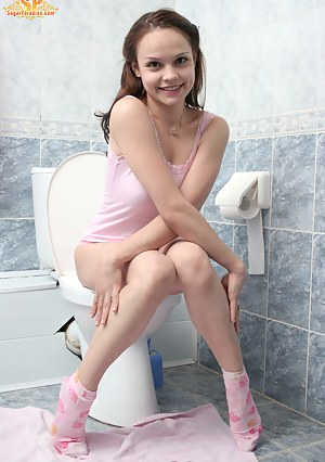 Marvelous girl noticed someone watching her in the toilet, she became so much excited, that undressed to the skin being right on the lavatory