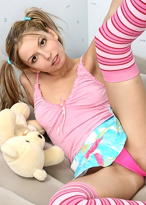 Playful teen chick is waiting for you right in this gallery in order to please you with her nice show.