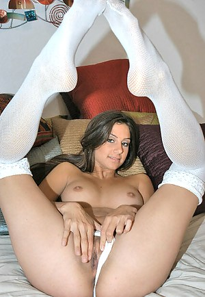 Filthy brunette is taking off her jeans skirt and touching herself with great pleasure. She is forgetting about it all masturbating her pussy.