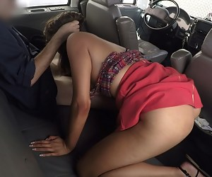Busty older woman wearing sexy red dress is demonstrating her great fuck skills. She is sucking big penis smiling right into the hidden cam.
