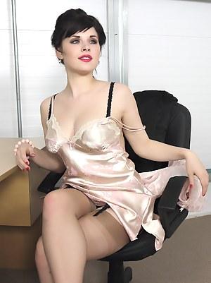 Dishy secretary Jocelyn-Kay takes time off work for a saucy office striptease