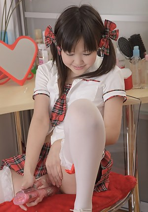Innocent japanese teenager plays with a sex toy in her muff