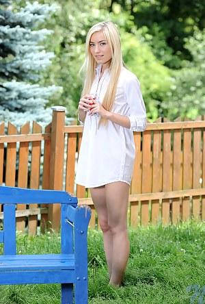 Playful teen Diana Fox strips naked in her backyard and masturbates