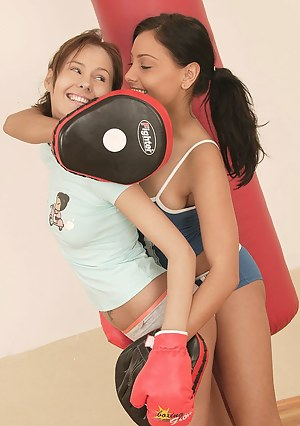 Two boxing lesbian brunette teenagers teasing eachother