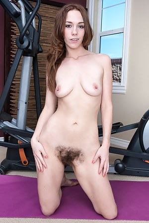Sexy Sammy is meeting with her trainer for the first time and this frisky red head is ready to play hard! After learning the moves she shows him her stuff, including her hairy pussy!