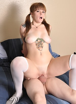 Tattooed redhead Mariah Mars gets fucked hard.