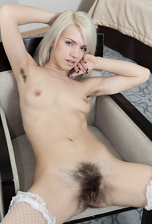 Hirsute porn model Selena loves her new assignment. She is able to wear sexy stockings and beautiful lingerie and have her pictures taken. She loves to slowly undress and show her hairy beauty.