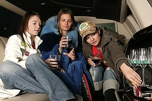 Three lesbian teens toying their pussies in a limousine