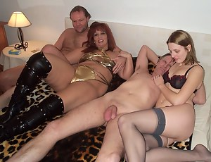 Two swinging couples get together on a bed