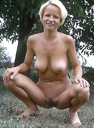 Blonde amateur girl showing her tight body in the bushes
