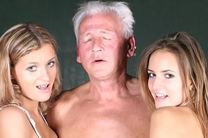 Horny grey senior enjoys two sweet babes their pussies