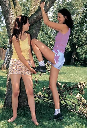 Cute lesbians getting naughty in the wood sharing dildos