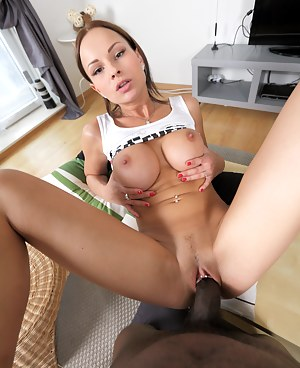 Busty brunette honey sucking and fucking a big black cock
