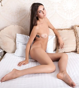 She will make you feel warm and welcome as she poses naked and gazes at you with her beautiful brown eyes.
