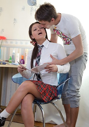 Pigtailed schoolgirl sucking and riding a large dick upskirt