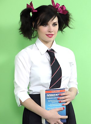 Cute college girl enjoys a lollipop as she strips from her uniform