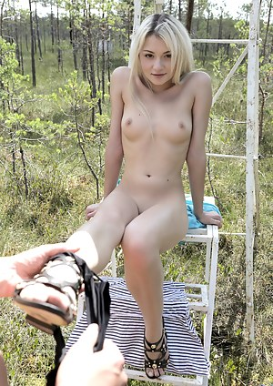 Petite blonde amateur fucks her mans stiff cock in the woods