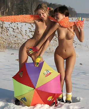 Extremely attractive kittens are playing on the snow fully nude and warm themselves with hot kisses.