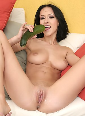 Slutty babe is looking great wearing purple clothes. She is pushing extremely long green vegetable deep into her sensual vagina.