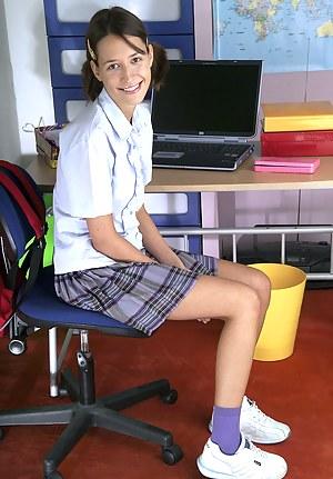 Brunette schoolgirl loves to rub her tight shaved pussy