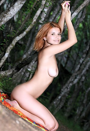 Amazing redhead babe showing off her shapely curves in the wilderness as she gets hornier and hornier by the second.