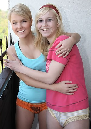 Two cute teen lesbians enjoy licking each others snatch