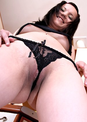 Lovely nubile girl Natie in black sheer clothing showing off and spreading in the kitchen