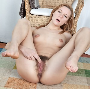 Home from a hike, hairy girl Ieva is stripping down to change when she decides to give her sore body some well needed loving instead in this hirsute gallery.